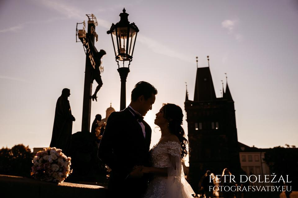 Pre Wedding Picture with Silhouettes on Charles bridge. The bridge is famous for its statues, towers at each end of Charles bridge and typical Prague lamps.