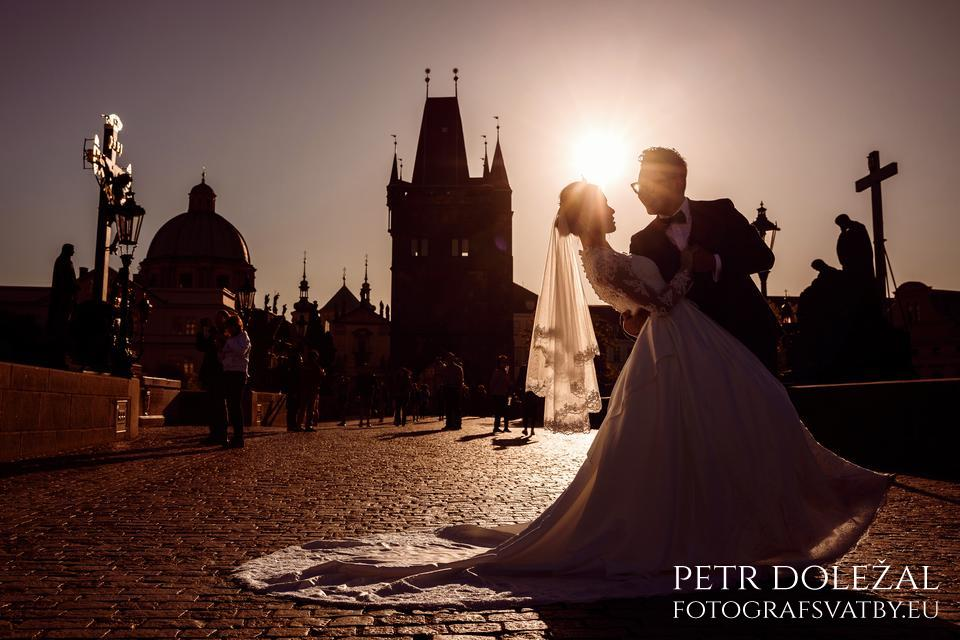 Pre Wedding in sunset on Charles bridge. You can see Old Town Bridge Tower in the background, which is built in Gothic architecture style.